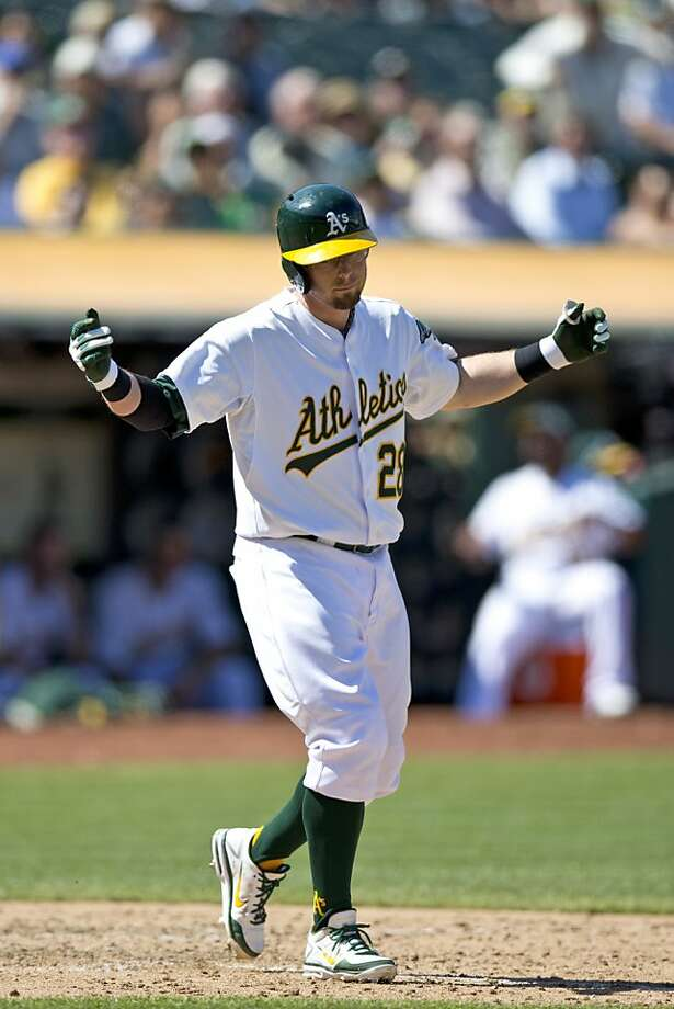 OAKLAND, CA - AUGUST 21: Eric Sogard #28 of the Oakland Athletics reacts after a called third strike against the Seattle Mariners during the ninth inning at O.co Coliseum on August 21, 2013 in Oakland, California. The Seattle Mariners defeated the Oakland Athletics 5-3. (Photo by Jason O. Watson/Getty Images) Photo: Jason O. Watson, Getty Images