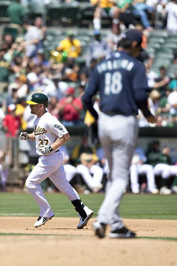 OAKLAND, CA - AUGUST 21: Brandon Moss #37 of the Oakland Athletics rounds the bases after hitting a home run off of Hisashi Iwakuma #18 of the Seattle Mariners during the fourth inning at O.co Coliseum on August 21, 2013 in Oakland, California. (Photo by Jason O. Watson/Getty Images) Photo: Jason O. Watson, Getty Images