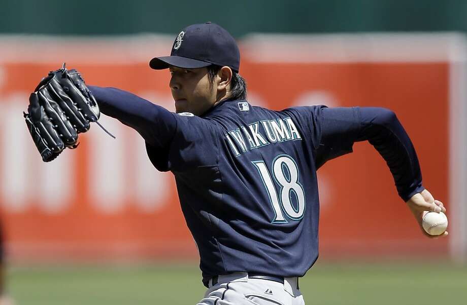 Seattle Mariners' Hisashi Iwakuma, of Japan, works against the Oakland Athletics in the first inning of a baseball game Wednesday, Aug. 21, 2013, in Oakland, Calif. (AP Photo/Ben Margot) Photo: Ben Margot, Associated Press
