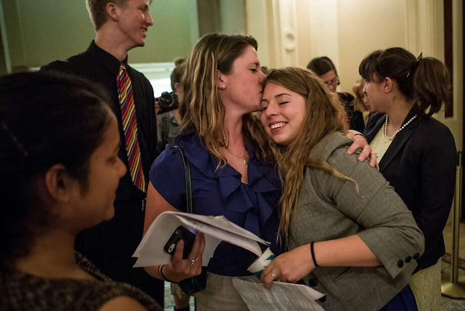 University of North Carolina Chapel Hill graduate and assault victim Annie Clark (center left) celebrates with Sofie Karasek. Photo: Max Whittaker/Prime, Special To The Chronicle
