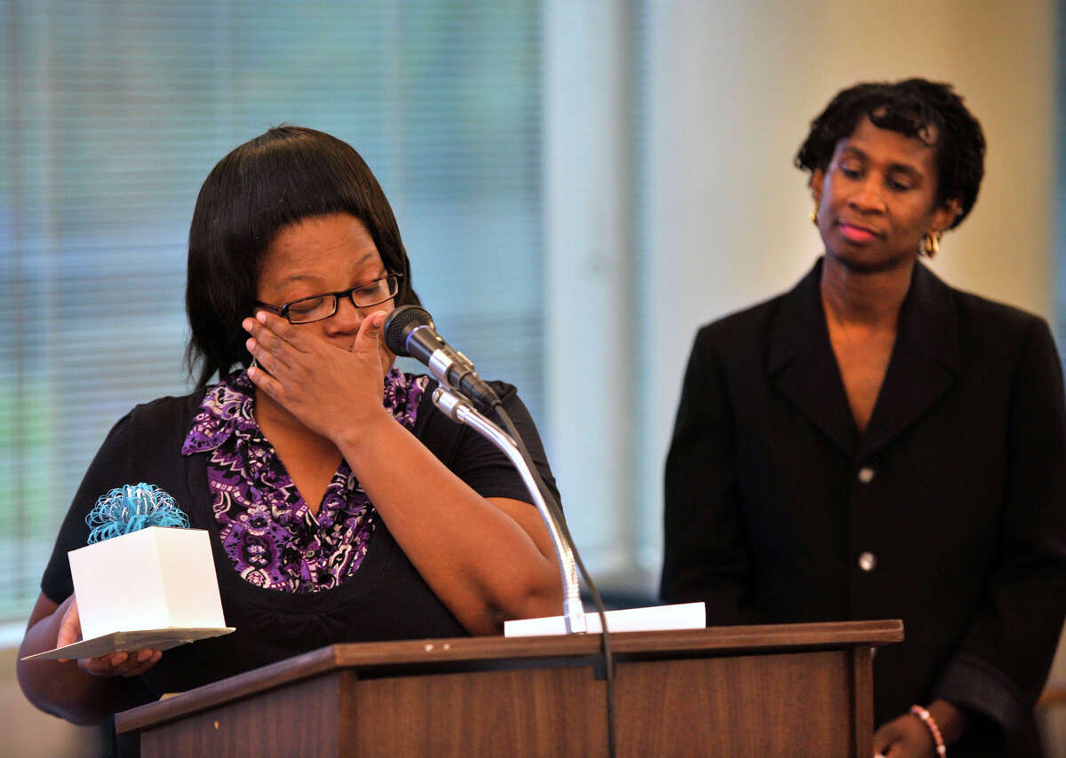 Paulette Miller tears up as she accepts a monetary honor for her daughter, Meteyana Miller, at the NAACP first annual scholarship award ceremony at the Stamford Government Center on Wednesday, Aug. 21, 2013..