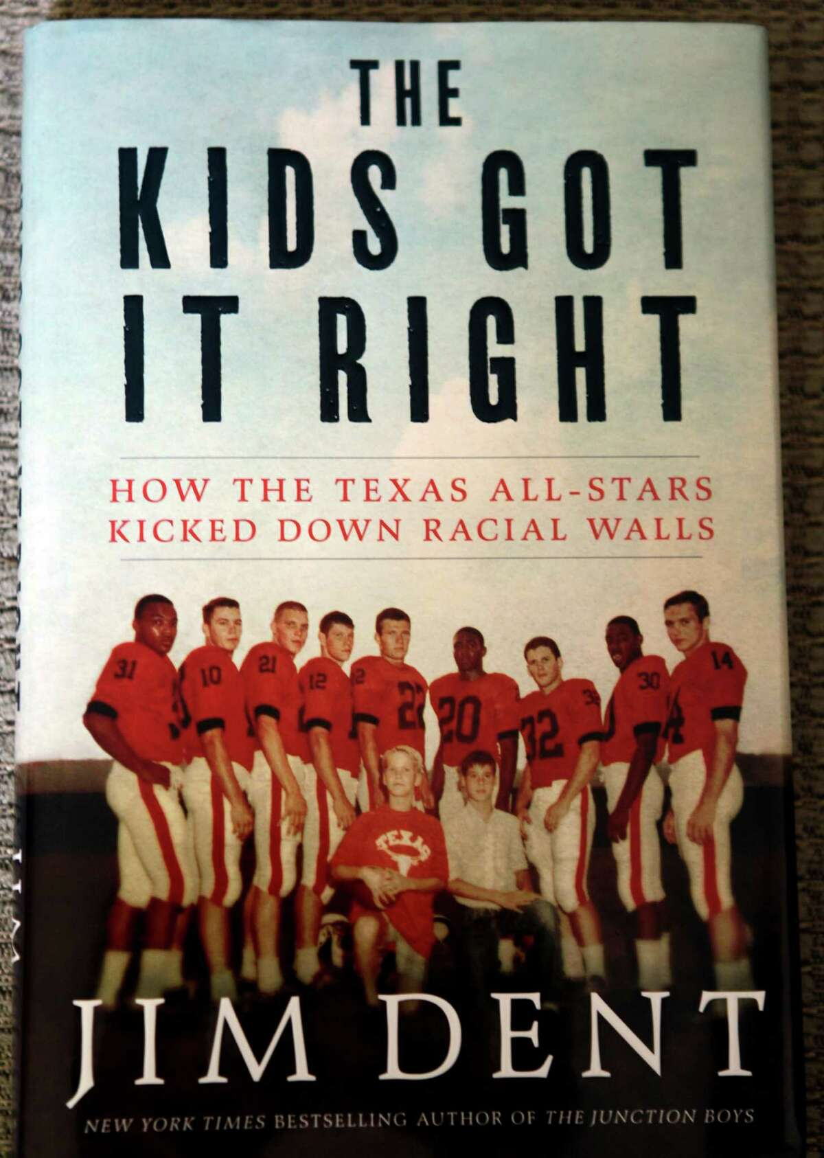 """Photo copy of book titled """"The Kids Got It Right: How the Texas All-Stars Kicked Down Racial Walls"""" by Jim Dent that features Jerry LeVias shown Wednesday, Aug. 21, 2013, in Houston. LeVias a former NFL player helped break the color barrier in football in the state of Texas. ( Melissa Phillip / Houston Chronicle )"""