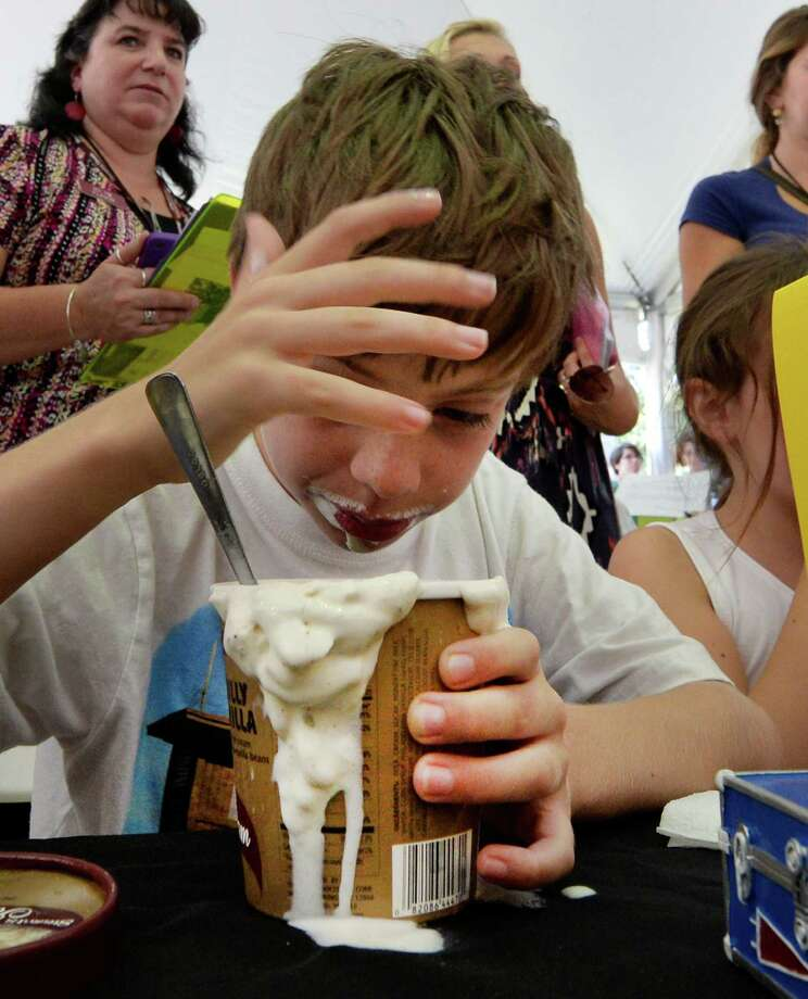 Andrew Desso, 9, of Painted Post has a little brain freeze while devouring a pint of Stewart's Philly Vanilla ice cream during the annual Stewart's ice cream eating contest Wednesday, Aug 19, 2013, at the Saratoga Race Course in Saratoga Springs, N.Y.  The contest is held annually during Travers Stakes week at the Spa.   (Skip Dickstein/Times Union) Photo: SKIP DICKSTEIN