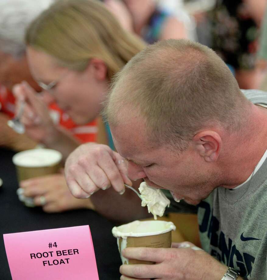 Josh Parkhurst, 38, of Rotterdam puts away a pint of Stewart's Philly Vanilla ice cream in a quick time of 41.1 seconds and won the Adult category during the annual Stewart's ice cream eating contest Wednesday, Aug 19, 2013, at  Saratoga Race Course in Saratoga Springs, N.Y.  The contest is held annually during Travers Stakes week at the Spa.   (Skip Dickstein/Times Union) Photo: SKIP DICKSTEIN