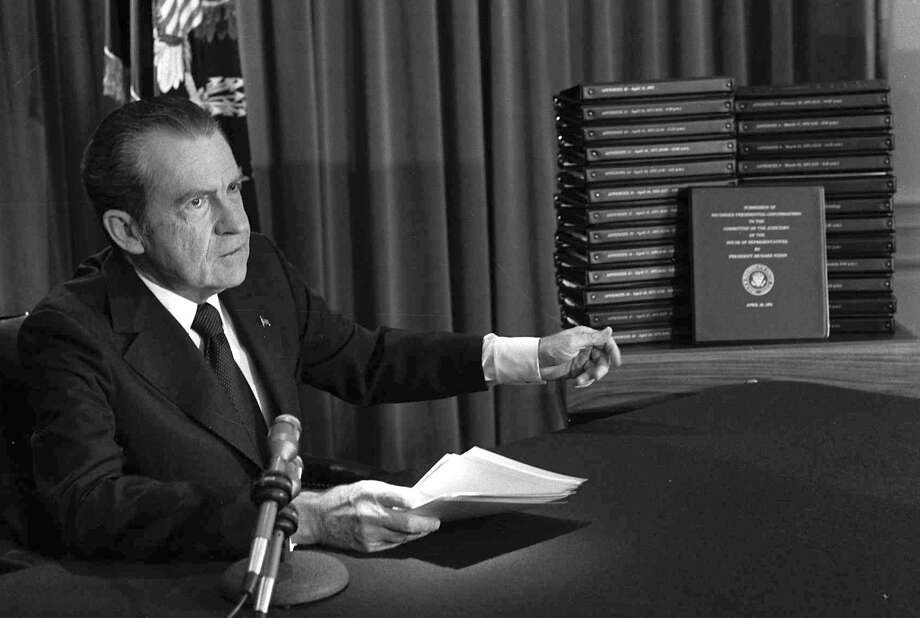 FILE - In this April 29, 1974, file photo, President Richard M. Nixon points to the transcripts of the White House tapes after he announced during a nationally-televised speech that he would turn over the transcripts to House impeachment investigators, in Washington. The last 340 hours of tapes from Nixon's White House were released Wednesday, Aug. 21, 2013, along with more than 140,000 pages of text materials. (AP Photo/File) Photo: STF / AP