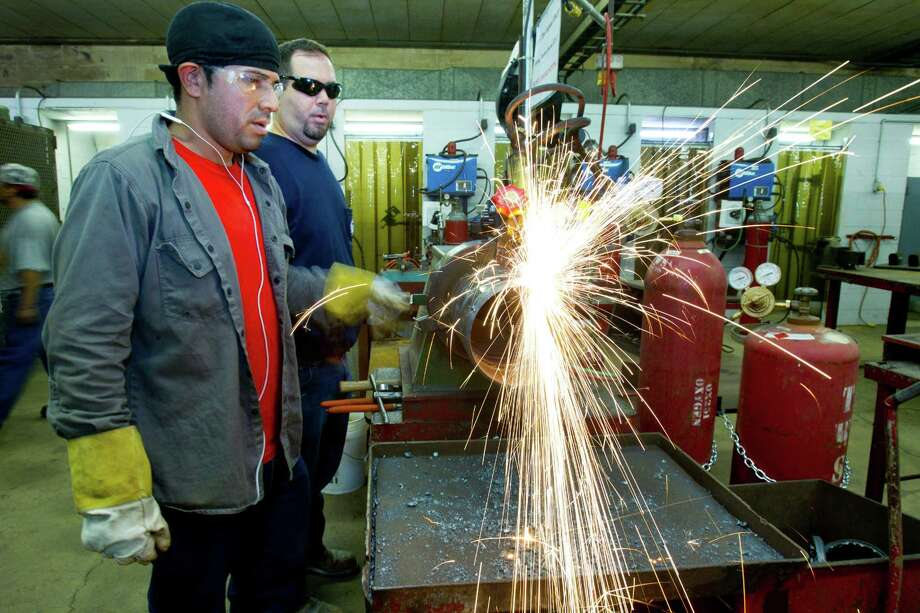 Jason Ducey, right, works with a fellow student at a pipe fitters training facility Wednesday, Aug. 21, 2013, in Houston. With the expanding production in North America, more trained workers are going to be needed. ( Brett Coomer / Houston Chronicle ) Photo: Brett Coomer, Staff / © 2013 Houston Chronicle