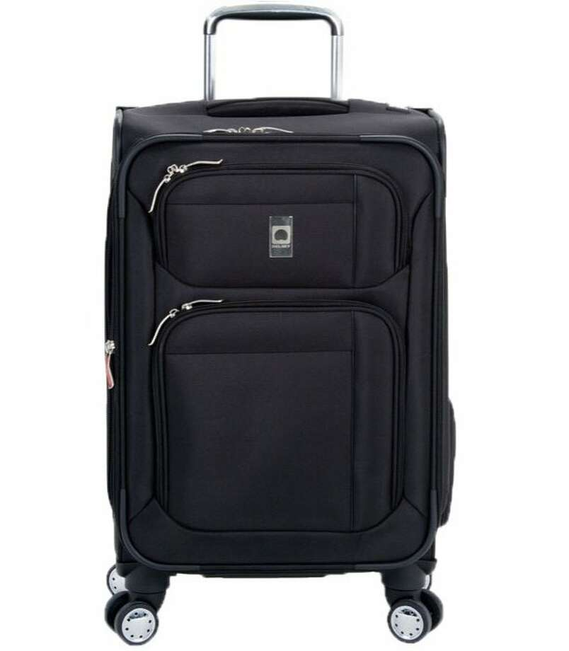 The Helium Breeze suitcase has an integrated laundry bag hatch and overweight indicator. Photo: Www.delsey.com
