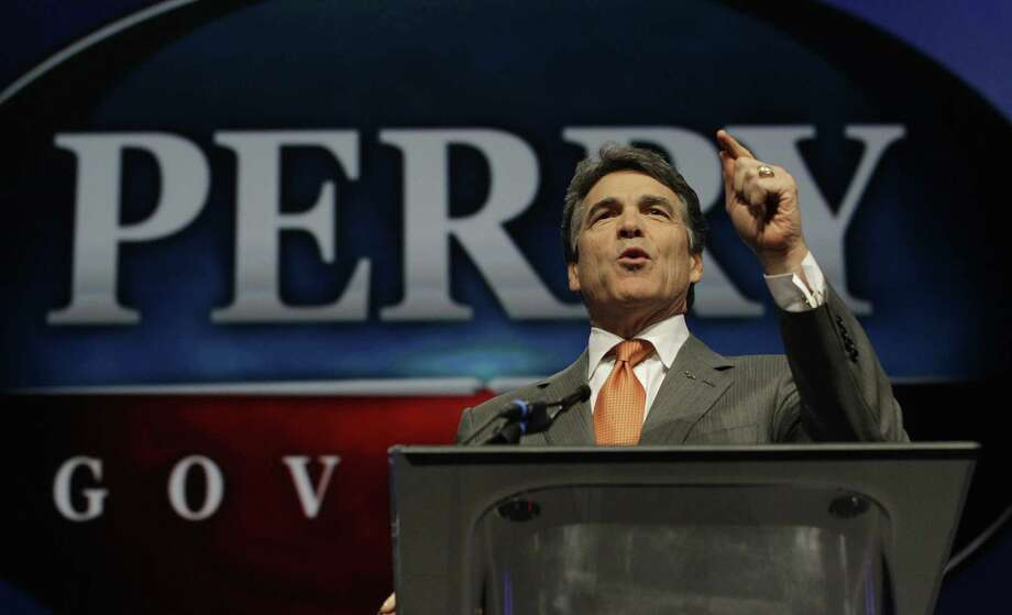 Gov. Rick Perry finds himself in the peculiar position of having to defend a GOP-authored bill he signed that's set to tap close to $100 million of Obamacare money. Photo: Associated Press File Photo