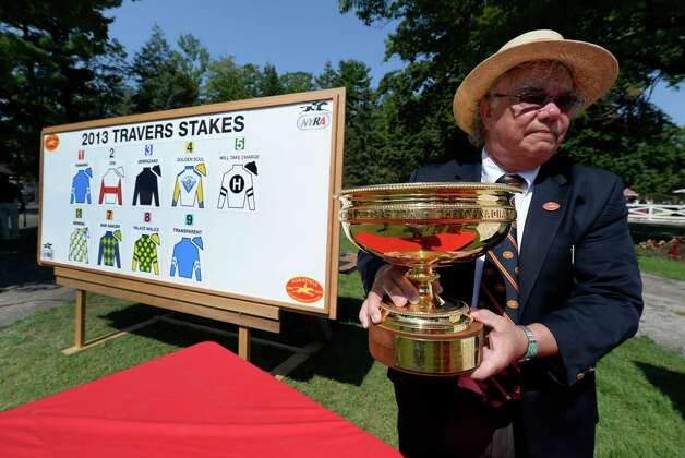 Dave Smith moves the Man o' War trophy which will be presented to the winner of the Travers Stakes was on display in the paddock of the Saratoga Race Course Aug 21, 2013 in Saratoga Springs, N.Y. during the post position draw in which  Verrazano was named the morning line favorite to win the Travers Stakes which will run on Saturday at Saratoga.  (Skip Dickstein/Times Union) Photo: SKIP DICKSTEIN
