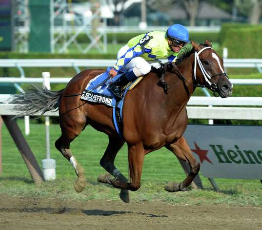 Escapefromreality ridden by jockey Javier Castellano put away the field of six to win the 36th running of The Albany - Big Apple Triple - Third Leg Aug 19, 2013 at the Saratoga Race Course in Saratoga Springs, N.Y.    (Skip Dickstein/Times Union) Photo: SKIP DICKSTEIN