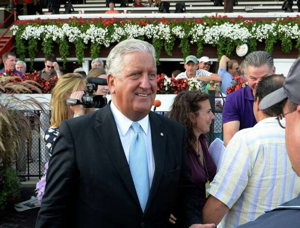 Albany Mayor Jerry Jennings makes his final presentation of the winner's trophy for the 36th running of The Albany - Big Apple Triple - Third Leg Aug 19, 2013 at the Saratoga Race Course in Saratoga Springs, N.Y.  Jenning leaves office on December 31st.    (Skip Dickstein/Times Union) Photo: SKIP DICKSTEIN