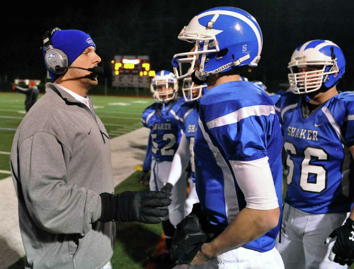 Shaker head coach Grag Sheeler with quarterback #5 Chris Landers on the sidelines during their Class AA state semifinal game against New Rochelle at Dietz Stadium in Kingston Saturday Nov. 17, 2012. (John Carl D'Annibale / Times Union)