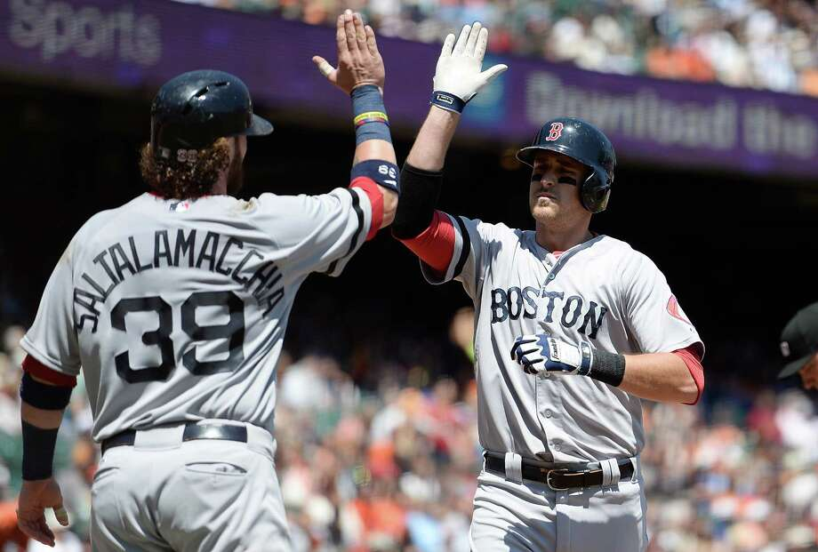 SAN FRANCISCO, CA - AUGUST 21:  Will Middlebrooks #16 of the Boston Red Sox is congratulated by Jarrod Saltalamacchia #39 after Middlebrooks hit a two-run homer in the second inning against the San Francisco Giants at AT&T Park on August 21, 2013 in San Francisco, California.  (Photo by Thearon W. Henderson/Getty Images) ORG XMIT: 163495134 Photo: Thearon W. Henderson / 2013 Getty Images