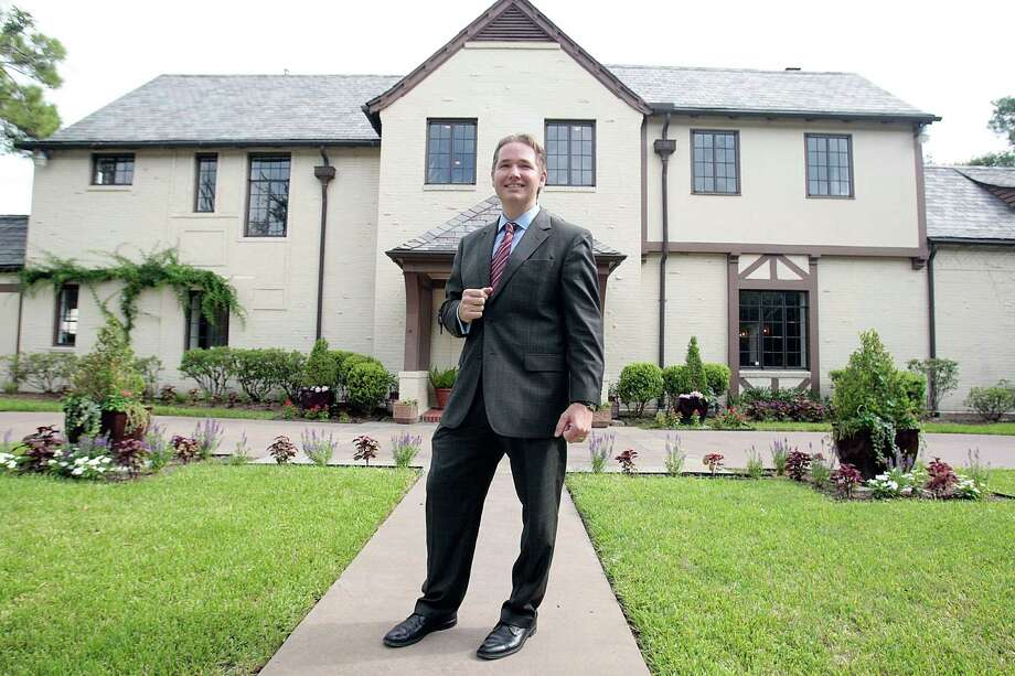 Real estate agent David Atkins says the home of a former governor should appeal to buyers who want to own a piece of history. Photo: Billy Smith II, Staff / © 2013 Houston Chronicle