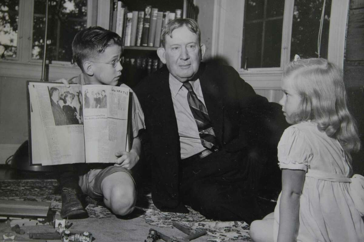 A photo of former governor William Hobby and his children are among the special decorating touches put in place for the open house at 2115 Glen Haven.