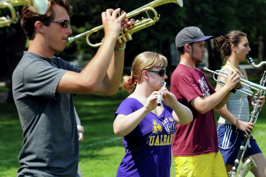 Flutist Emily Schlierer, 19, center, practices with fellow band members of the UAlbany Marching Great Danes on Wednesday, Aug. 21, 2013, at UAlbany in Albany, N.Y. (Cindy Schultz / Times Union) Photo: Cindy Schultz / 00023598A