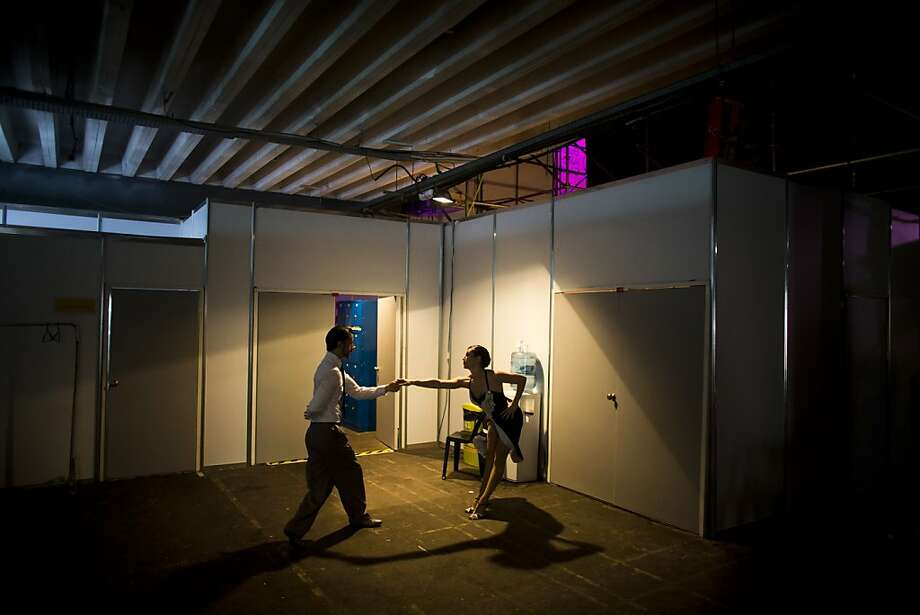 Dancers Elina Conte, right, and Emiliano Alcaraz practice backstage before performing in the 2013 Tango World Championship stage category in Buenos Aires, Argentina, Wednesday, Aug. 21, 2013. (AP Photo/Victor R. Caivano) Photo: Victor R. Caivano, Associated Press