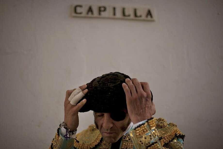 Spanish matador Juan Jose Padilla prepares to take part in a bullfight at the Malagueta Bullring in Malaga on August 21, 2013.  AFP PHOTO/ JORGE GUERREROJorge Guerrero/AFP/Getty Images Photo: Jorge Guerrero, AFP/Getty Images