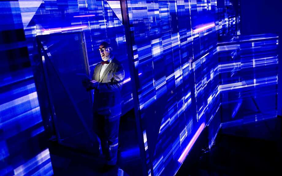"Bass baritone Stephen Bronk performs in a lit up maze during the dress rehearsal of the ""Celestial Mechanics - displaced and relocated"" production at the German Opera in Berlin on August 20, 2013. The production by Artisitic Director Sven Soeren Beyer of phase 7, is played out over three levels at the Berlin opera house foyer area and uses Mauricio Kagel's 1965 composition as a point of departure.  AFP PHOTO / ODD ANDERSENODD ANDERSEN/AFP/Getty Images Photo: Odd Andersen, AFP/Getty Images"
