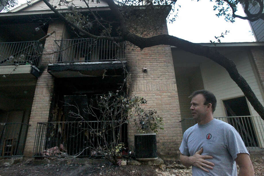 Blanco Crossing resident Shane Knight stands outside of a burned unit where a fire broke out. He knocked on doors to alert neighbors to the danger. Photo: John Davenport / San Antonio Express-News