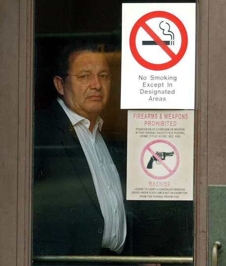 Attorney H. Jack Pytel, shown after his arrest by the FBI in October 2002, was sentenced to nine months in prison followed by two years of federal supervision for his role in a City Hall corruption scandal that also saw two councilmen sentenced to prison. Photo: San Antonio Express-News File Photo
