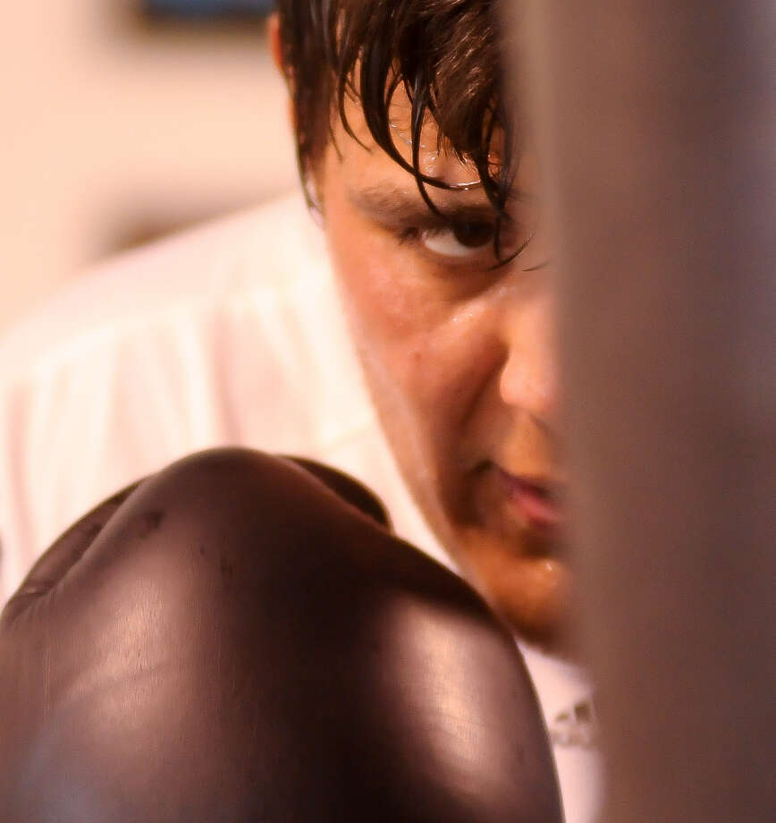 Despite the rise of his former sport, ex-MMA fighter Aaron Rosa of Del Rio ultimately decided he preferred boxing. Photo: Robin Jerstad / For The Express-News