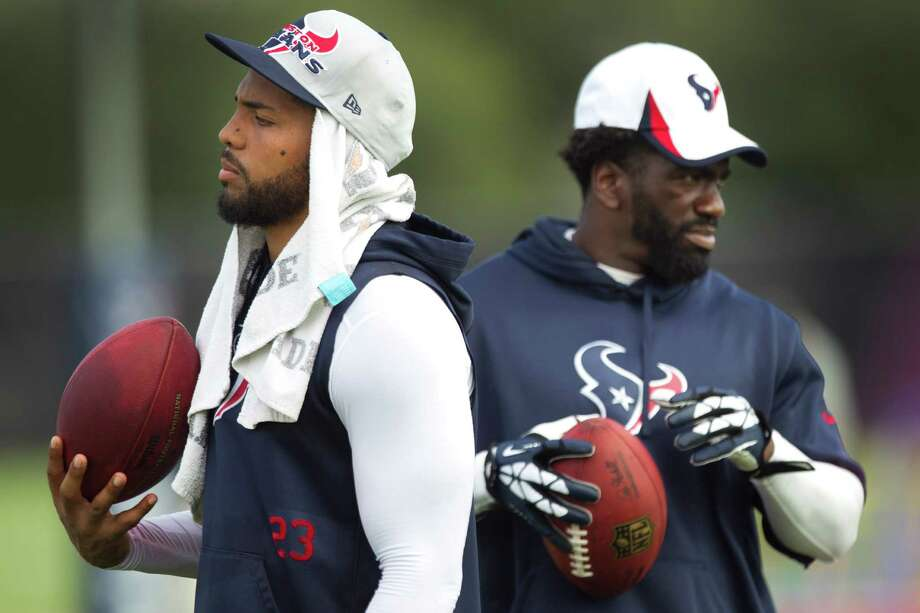 It's one down, one to go for getting prominent Texans players off the PUP list. Running back Arian Foster, left, is ready to practice, while the time frame for safety Ed Reed remains unclear. Photo: Brett Coomer, Staff / © 2013 Houston Chronicle