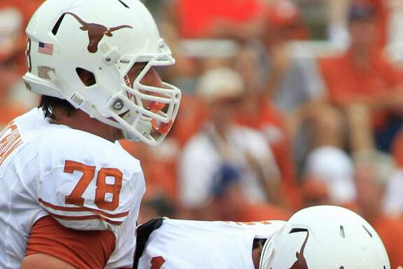 Texas quarterback David Ash, right, is determined to lead by example and show more toughness when the going gets rough for the Longhorns this season.