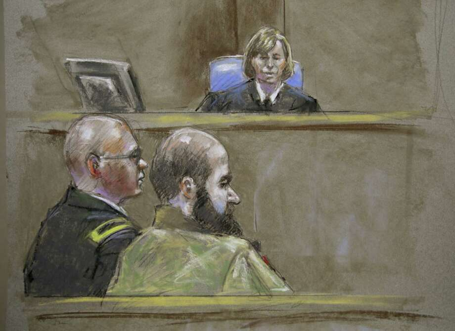 This courtroom sketch portrays Maj. Nidal Hasan (foreground) and attorney Lt. Col. Kris Poppe in front of the judge, Col. Tara Osborn. Photo: Associated Press