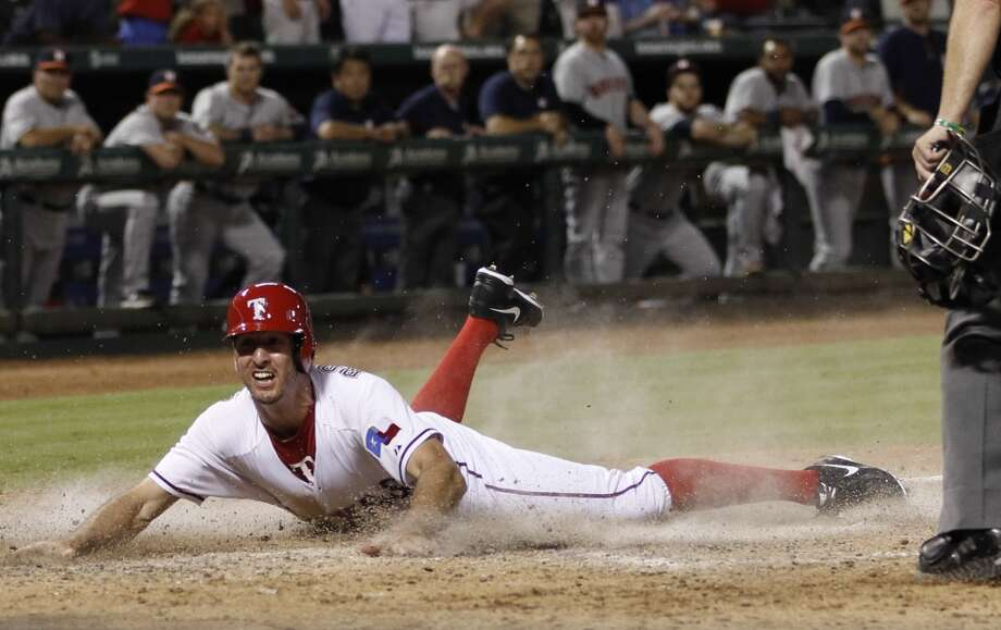 Aug. 21: Rangers 5, Astros 4  Adam Rosales slides home with the game-winning run on a sacrifice fly by Elvis Andrus. Photo: Jim Cowsert, Associated Press