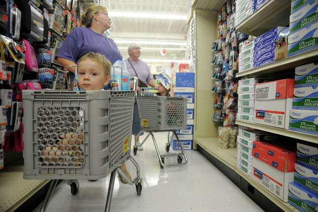 Gavin Raynor, 2, from Rensselaer sits in a cart pushed by his grandmother, Tamara Tschantret, as Tamara's mother, Kathy Jarvis pushes her grandson, Jacob Jarvis, 8, as they shopped during the grand opening of Ollie's Bargain Outlet at Crossgates Commons on Wednesday, Aug. 21, 2013 in Albany, NY. (Paul Buckowski / Times Union) Photo: Paul Buckowski / 00023569A