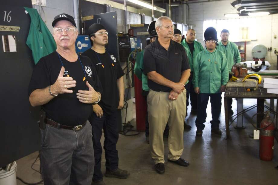 Instructor Don Booth gives a tour of a pipefitters training facility on Aug. 21, 2013, in Houston. With the expanding production in North America, more trained workers are going to be needed. Photo: Brett Coomer, Houston Chronicle
