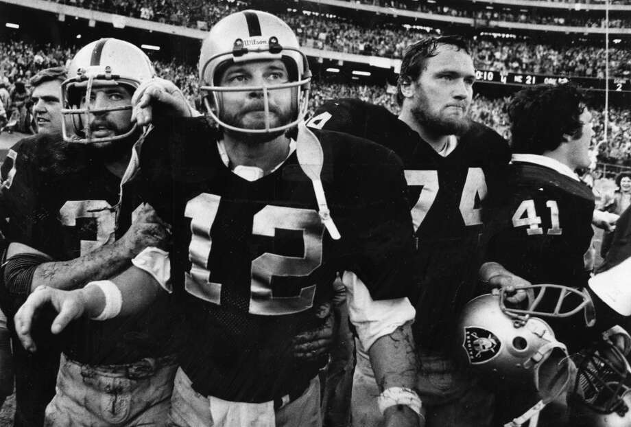 Still covered in sweat and turf from the Oakland-Alameda County Coliseum, Ken Stabler heads off the field. The Raiders beat the Patriots 24-21 in the playoff opener, on a one-yard Stabler TD run. Photo: Dave Randolph, The Chronicle