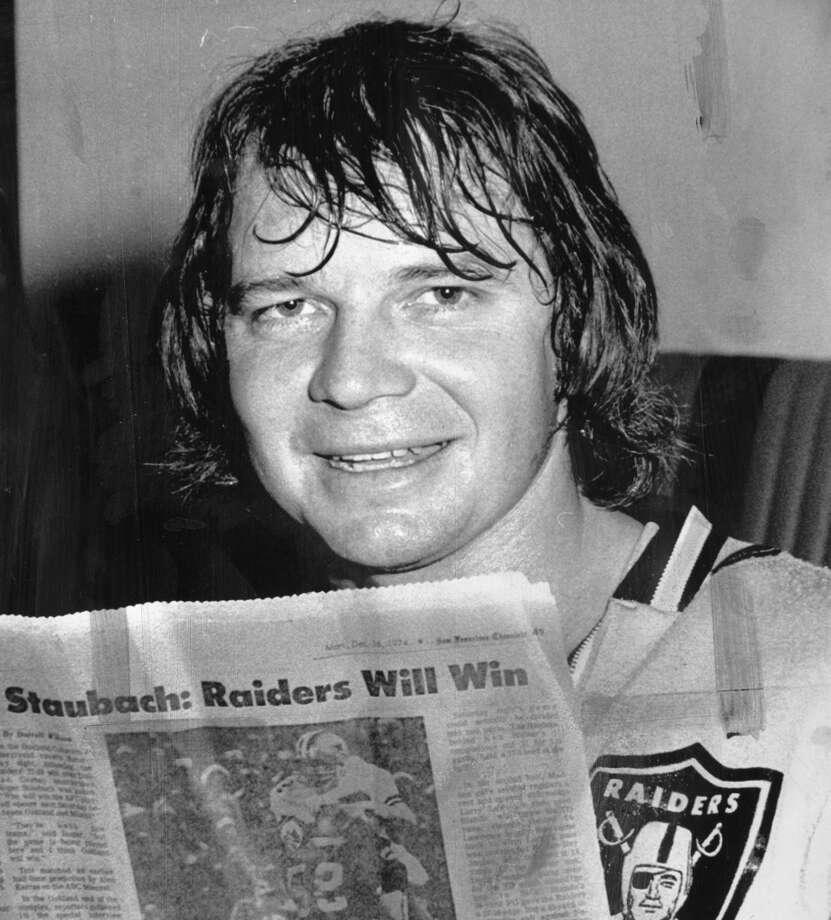 A youthful-looking Ken Stabler reads the Chronicle's Sporting Green in 1974, after a end-of-season win over Dallas. The Raiders would beat Miami, then lose to Super Bowl IX champion Pittsburgh. Photo: Associated Press