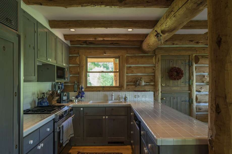 Original cabin kitchen. All photos via  Hall and Hall. http://hallhall.com/ranches-for-sale/properties/pioneer-moon-ranch