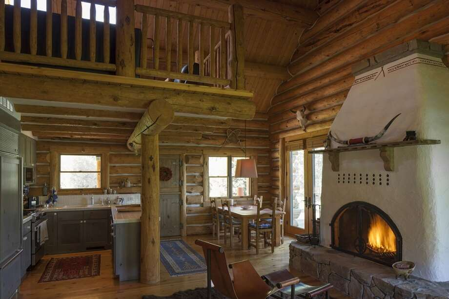 Fireplace, original cabin, where McQueen must have warmed his bones. All photos via  Hall and Hall. http://hallhall.com/ranches-for-sale/properties/pioneer-moon-ranch