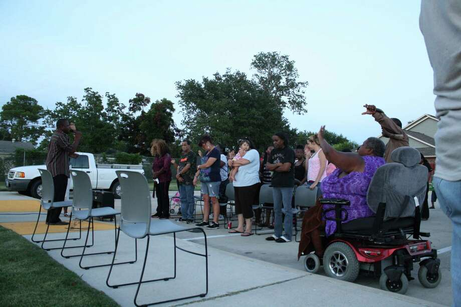 Port Arthur and Lakeview Palms Townhome residents gathered at the complex for a vigil to a one-month old child who sustained life-threatening injuries. The Department of Family and Protective Services are hopeful the child will survive the injuries. Photo: Jose D. Enriquez III