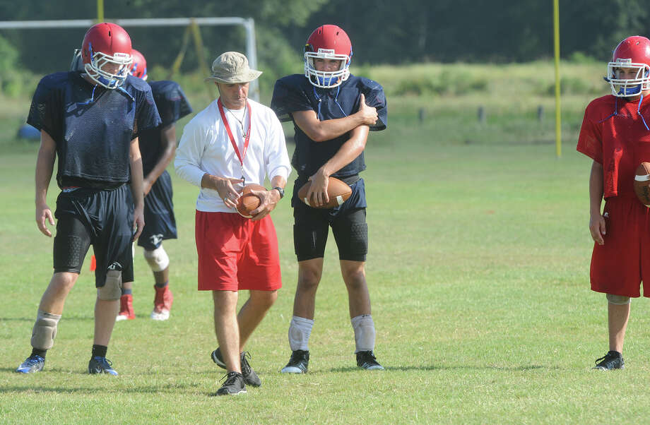 Hardin Jefferson's Hawks take to the practice field Friday to run drill and plays as head coach Dwayne DuBois instructs. Photo taken Friday, August 09, 2013 Guiseppe Barranco/The Enterprise Photo: Guiseppe Barranco, STAFF PHOTOGRAPHER / The Beaumont Enterprise