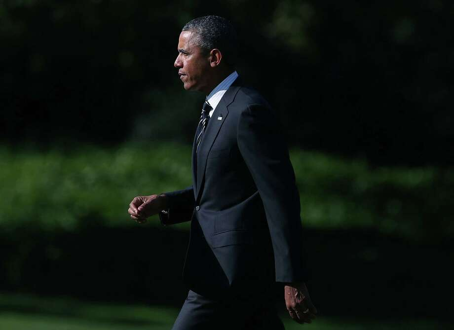 WASHINGTON, DC - AUGUST 22: U.S. President Barack Obama walks toward Marine One while departing the White House August 22, 2013 in Washington, DC. President Obama is traveling to New York and Pennsylvania, where he will discuss plans to make college more affordable.  (Photo by Mark Wilson/Getty Images) ORG XMIT: 177621511 Photo: Mark Wilson, Getty / 2013 Getty Images