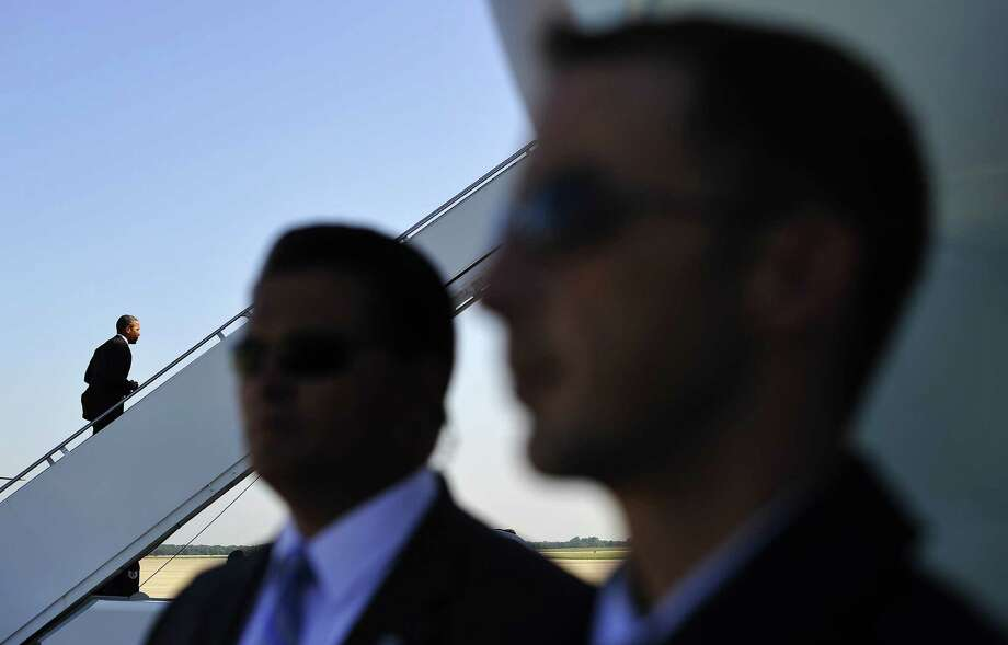 US President Barack Obama (L) boards Air Force One at Andrews Air Force Base in Maryland on August 22, 2013 en route to Buffalo, New York. Obama is on a two-day bus tour through New York and Pennsylvania to discuss his plan to make college more affordable, tackle rising costs, and improve value for students and their families. AFP Photo/Jewel SamadJEWEL SAMAD/AFP/Getty Images Photo: JEWEL SAMAD, Getty / AFP