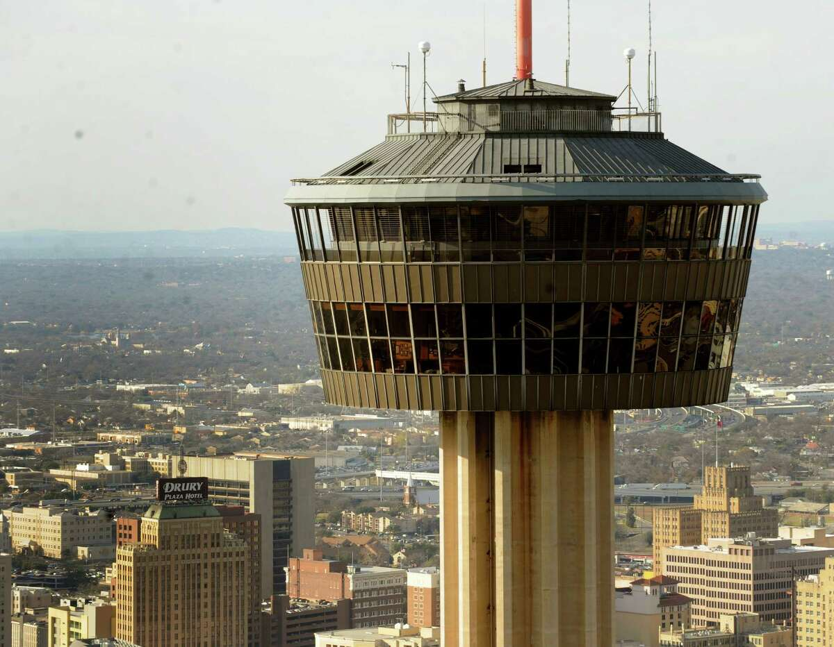 The Tower of the Americas looms over the city of San Antonio on Jan. 19, 2011.