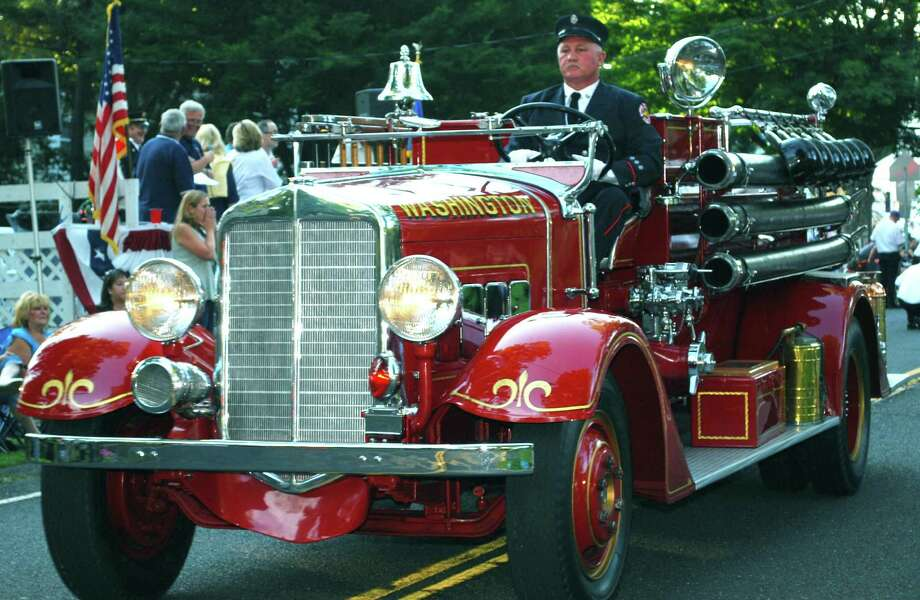 Al Swanson of the Washington Volunteer Fire Department navigates the departmentís 1936 Maxim, which the department bought new in 1936, in the Aug. 16, 2013, parade at the Bridgewater Country Fair, held Aug. 16-18, 2013. Photo: Deborah Rose