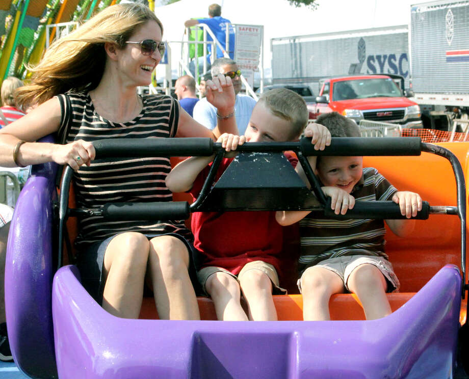 Melody Olmstead of New Milford shares a ride on the Sizzler with her son, Jackson, 4, right, and Joseph Russell, 4, at the Bridgewater Country Fair, Aug. 17, 2013 Photo: Walter Kidd