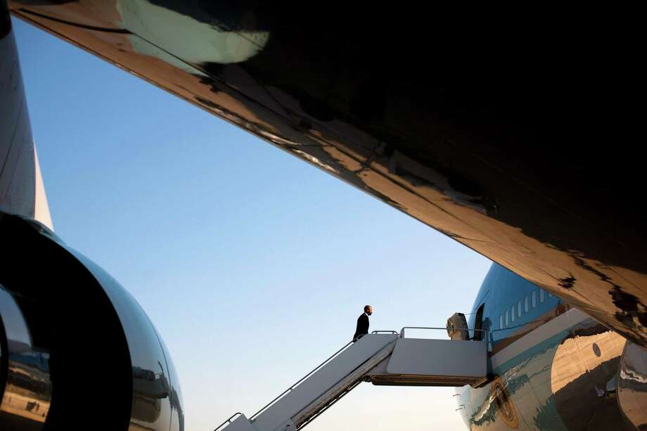 President Barack Obama boards Air Force One en route to Buffalo, N.Y. to deliver a speech on college costs, at Andrews Air Force Base, Md., Aug. 22, 2013. Obama plans to announce a set of ambitious proposals Thursday aimed at making colleges more accountable and affordable by rating them and ultimately linking those ratings to the amount of financial aid distributed. (Christopher Gregory/ The New York Times) ORG XMIT: XNYT1 Photo: CHRISTOPHER GREGORY, New York Times / NYTNS