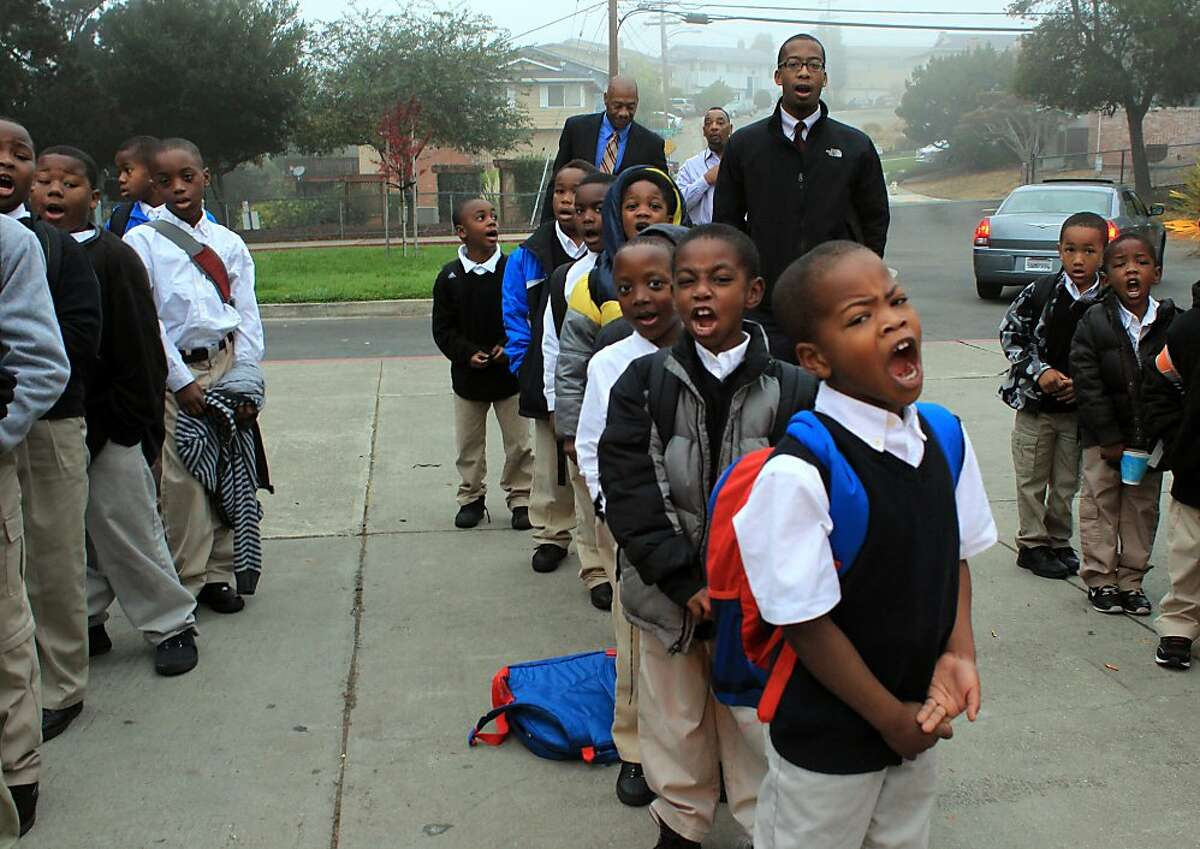 Mr. Edward Ewell's first grade class chants the scholar holler along with all the students at the beginning of their school day, Tuesday, October 30, at the100 Black Men Community Charter School in Oakland, Calif.