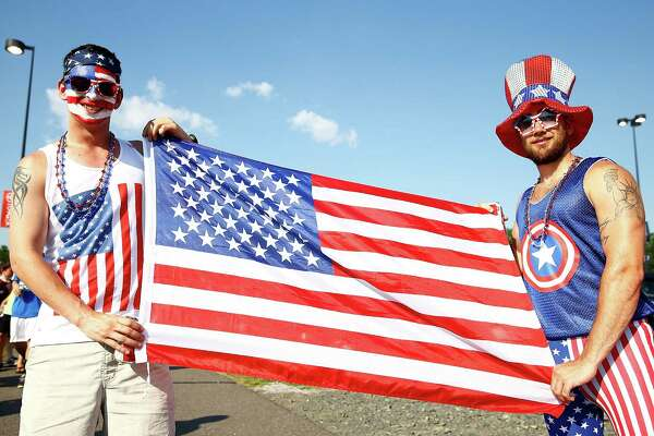 HARTFORD, CT - JULY 16: USA fans pose for a portrait outside of the stadium with the American flag prior to the USA vs Costa Rica CONCACAF Gold Cup match at Rentschler Field on July 16, 2013 in East Hartford, Connecticut.