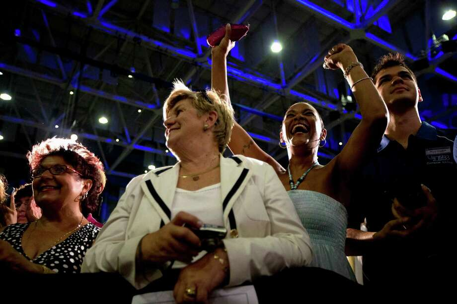 People cheer as President Barack Obama speaks at the University at Buffalo, in Buffalo, N.Y., Thursday, Aug. 22, 2013, beginning his two day bus tour to speak about college financial aid. Photo: Jacquelyn Martin