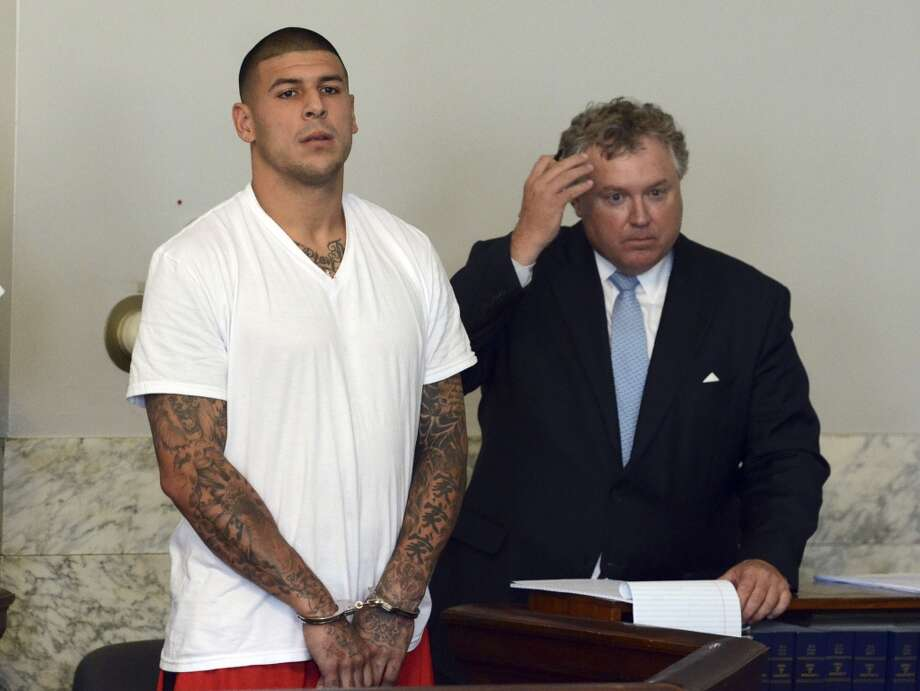 "UGLY: Former New England Patriots tight end Aaron Hernandez, left, and his attorney Michael Fee, right. Hernandez was charged with murdering Odin Lloyd, a 27-year-old semi-pro football player for the Boston Bandits. EA Sports also pulled Hernandez from ""Madden"" and ""NCAA Football"" games."
