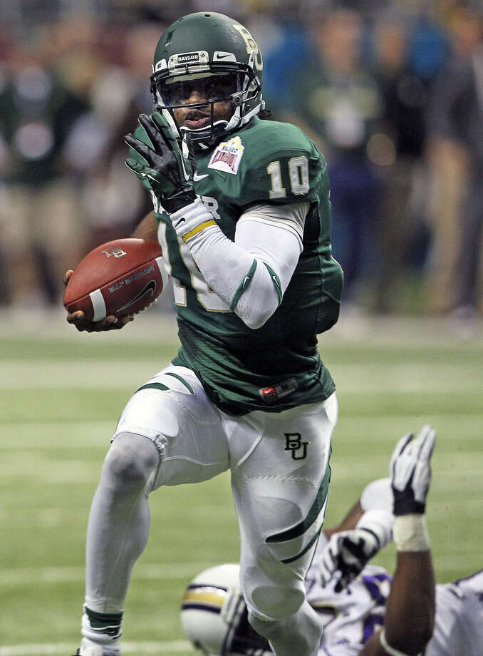 Robert Griffin III helped lead Baylor to a wild 67-56 victory over Washington in the 2011 Valero Alamo Bowl, capping his college career with 350 total yards. Photo: Tom Reel / San Antonio Express-News
