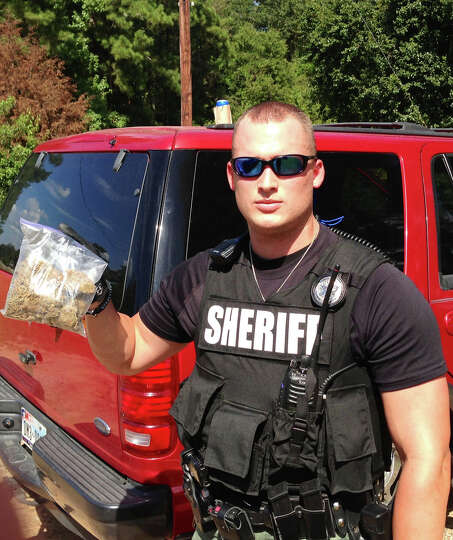 Deputy Logan of the Newton County Sheriffs Office with the confiscated drugs.  courtesy photo